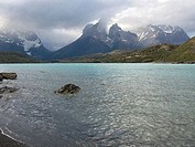 Clouds over a lake with mountains in the background, Lake Pehoe, Cuernos Del Paine, Torres del Paine National Park, Patagonia, Chile