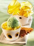 Stewed mangoes with pistachio ice cream