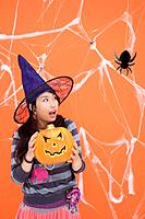 View of a teenage girl with jack-o-lantern