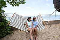 A couple sitting on hammock