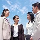 Low angle view of a businessman talking to three businesswomen