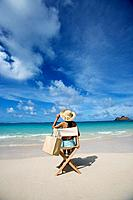 A woman sitting on chair on beach