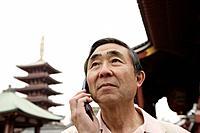 Close-up of a senior man using mobile phone