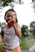 A girl blowing bubbles