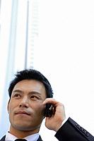 Businessman conversing on a cellphone, close-up