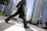 Businessman walking on a crosswalk