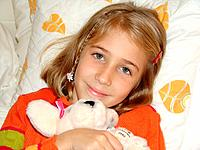 one girl holding a plush bear