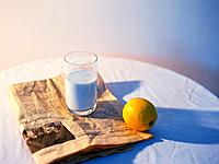 Milk, Lemon and Newspaper, High Angle View, Differential Focus
