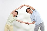 Image of Two Mature Adult People Stretching, Looking at a Camera, Front View, Three Quarter Length