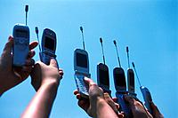 Seven People Holding a Mobile Phone, Low Angle View
