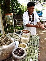 person selling dried fruits and grains seeds