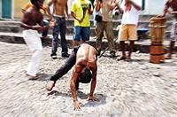 some men playing capoeira at bahia
