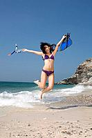 Asia, Thailand, Young woman jumping on beach
