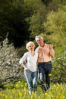 Germany, Baden Württemberg, Tübingen, Senior couple walking in rural landscape
