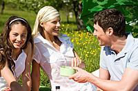 Germany, Baden Württemberg, Tübingen, Family having picnic in meadow