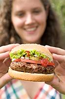 Woman holding hamburger