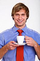 Young man holding cup of coffee, portrait
