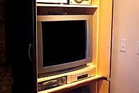 a tv set rack at the living room