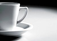 a white porcelain cup of coffee