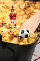 Cheese & onion pasta bake, football figure & football detail