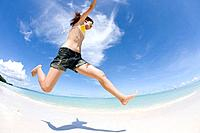 Woman jumping on beach, fish_eye lens, Saipan