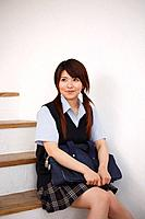 High School Student Sitting on Stairs