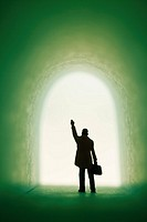 Silhouette of business person waving