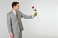 Businessman holding rose