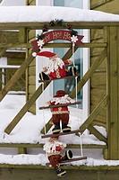 Santa on steps with snow around, close_up