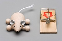 Mouse figurine by mousetrap