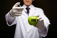 Scientist showing an apple