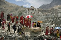 Buddhist monks walking down mountain, Diskyid Monastery in background, Nubra Valley, Leh Ladakh, India