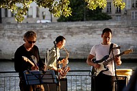France. Paris. A band play on the bank of River Seine under later afternoon sunlight during Paris Plage.