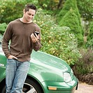 Mature man looking at a mobile phone and smiling