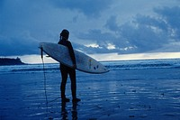 Surfer looking out to sea, Tofino, BC