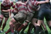Close up of rugby players in mud