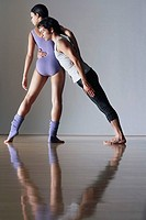 Ballet dancer leaning against ballerina