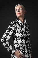 Stylish Senior Woman in black and white coat