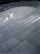 Two athletes fencing in the Scoop amphitheatre London England elevated view