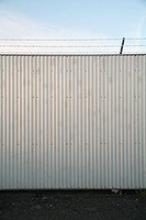 Wall topped with barb wire