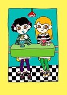 Two girls having ice cream sundaes