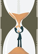 A businessman being covered by sand in an hourglass (thumbnail)