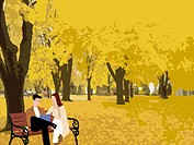 A couple sitting together in a park in autumn