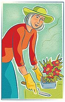 An elderly woman potting flowers
