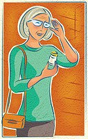 An elderly woman looking at her medication bottle (thumbnail)