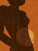 Silhouette of a woman with a spotlight on her abdomen