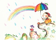 Little girl holding umbrella and looking at a rainbow