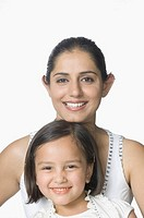 Portrait of a young woman and her daughter smiling