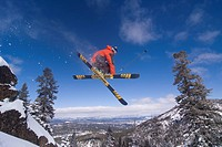 A man skiing powder snow at Northstar at Tahoe ski area near Lake Tahoe in California