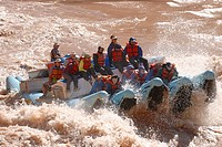 Raft going through Lava rapid a giant rapid on the Colorado river in the Grand Canyon Arizona USA MR